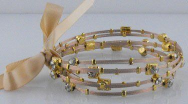 Seasonal Whispers Designer Bracelet, Rose Gold Color and Gold, Beautifully Hand Set with Swarovski Crystals Seasonal Whispers, http://www.amazon.com/dp/B008LMQS0U/ref=cm_sw_r_pi_dp_3H6Tqb0YJCP4W