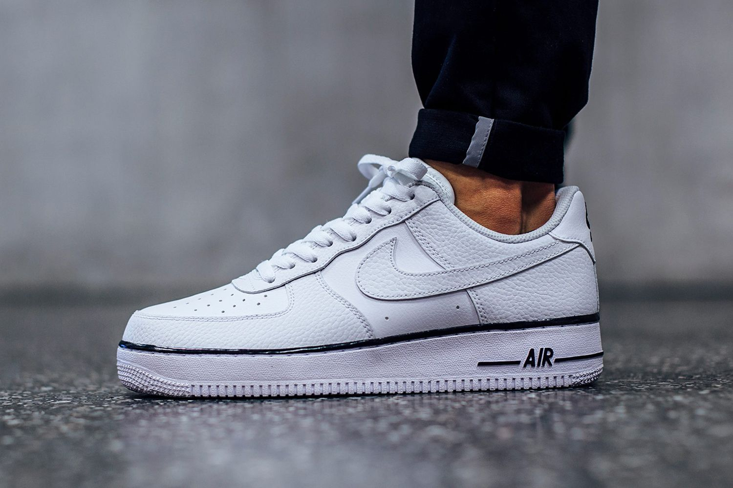 5c4e621abb83b2 Nike s Latest White Air Force 1 Sports a Dash of Black