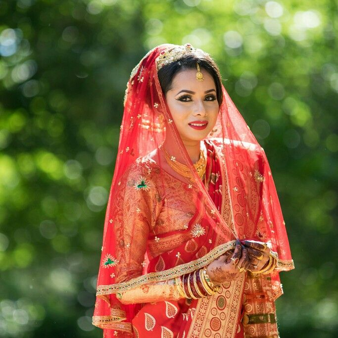 Bride in the red dress nepali indian bride wearing red saarinen nepali indian bride wearing red saarinen with a red veil junglespirit Image collections