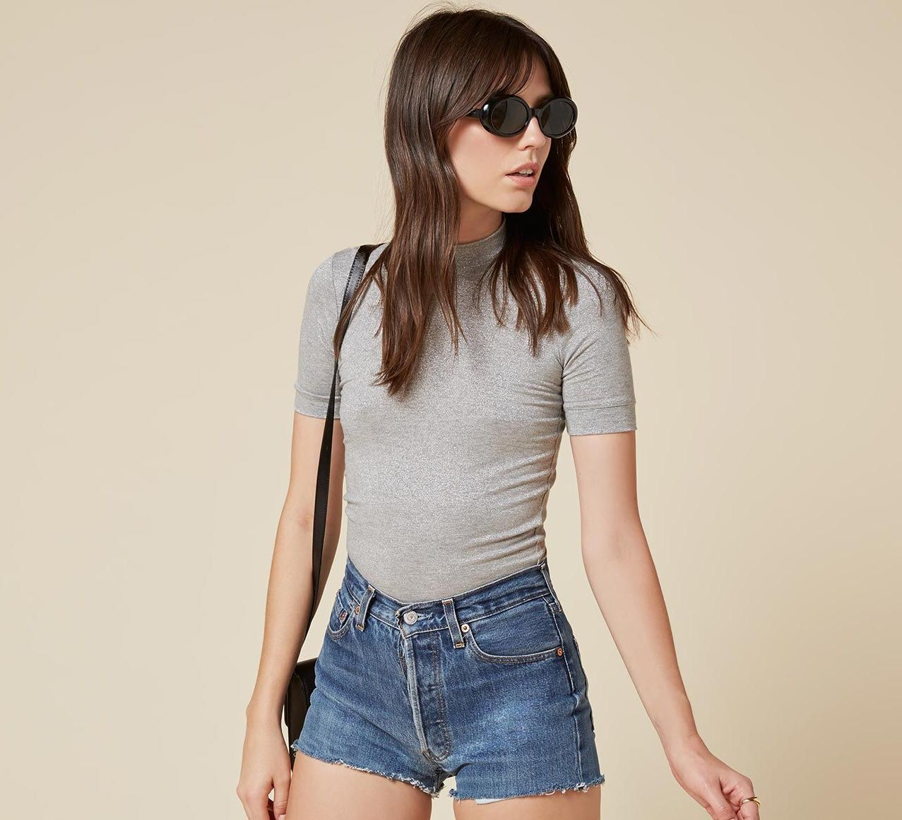 Go mod in a gray mockneck tee from Reformation. Tops