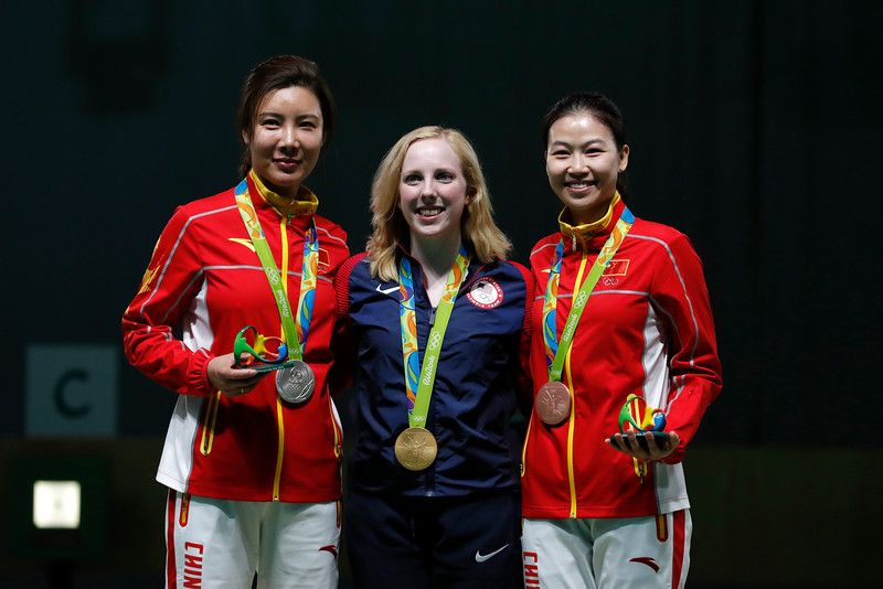 Gold medal winner, Virginia Thrasher of the United States, center, poses for a picture with silver medal winner, Du li of China, left, and bronze medalist China's Yi Siling, during the victory ceremony for the Women's 10m Air Rifle event at Olympic Shooting Center at the 2016 Summer Olympics in Rio de Janeiro, Brazil, Saturday, Aug. 6, 2016. (AP Photo/Hassan Ammar)