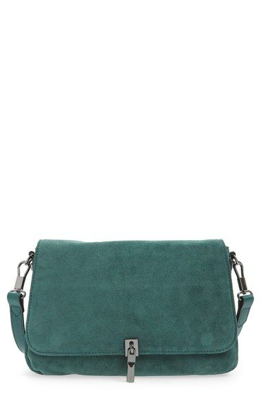 ba9ffa5a25 A sized-down version of the favorite Cynnie bucket bag goes elegant in  emerald green suede with matching leather trim. Silvery hardware