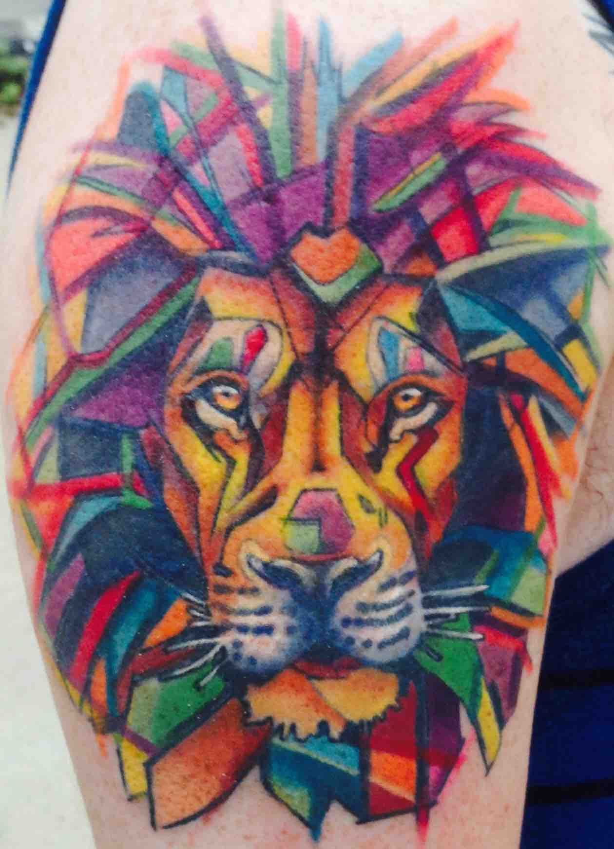 Watercolor Lion by James Hurley at Eclectic Tattoo Lansing, Michigan.