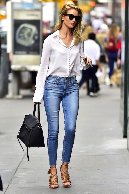 8a5217747e Rosie Huntington-Whiteley was spotted in a casual chic look in NYC. The  model elevated her raw-hem Paige Denim skinny jeans with a button-front  white blouse ...