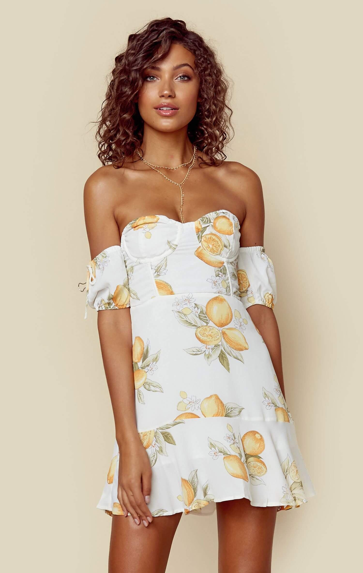 7096de1a99f9 The For Love and Lemons Lemonade Mini Dress features off shoulder sleeves  with ties