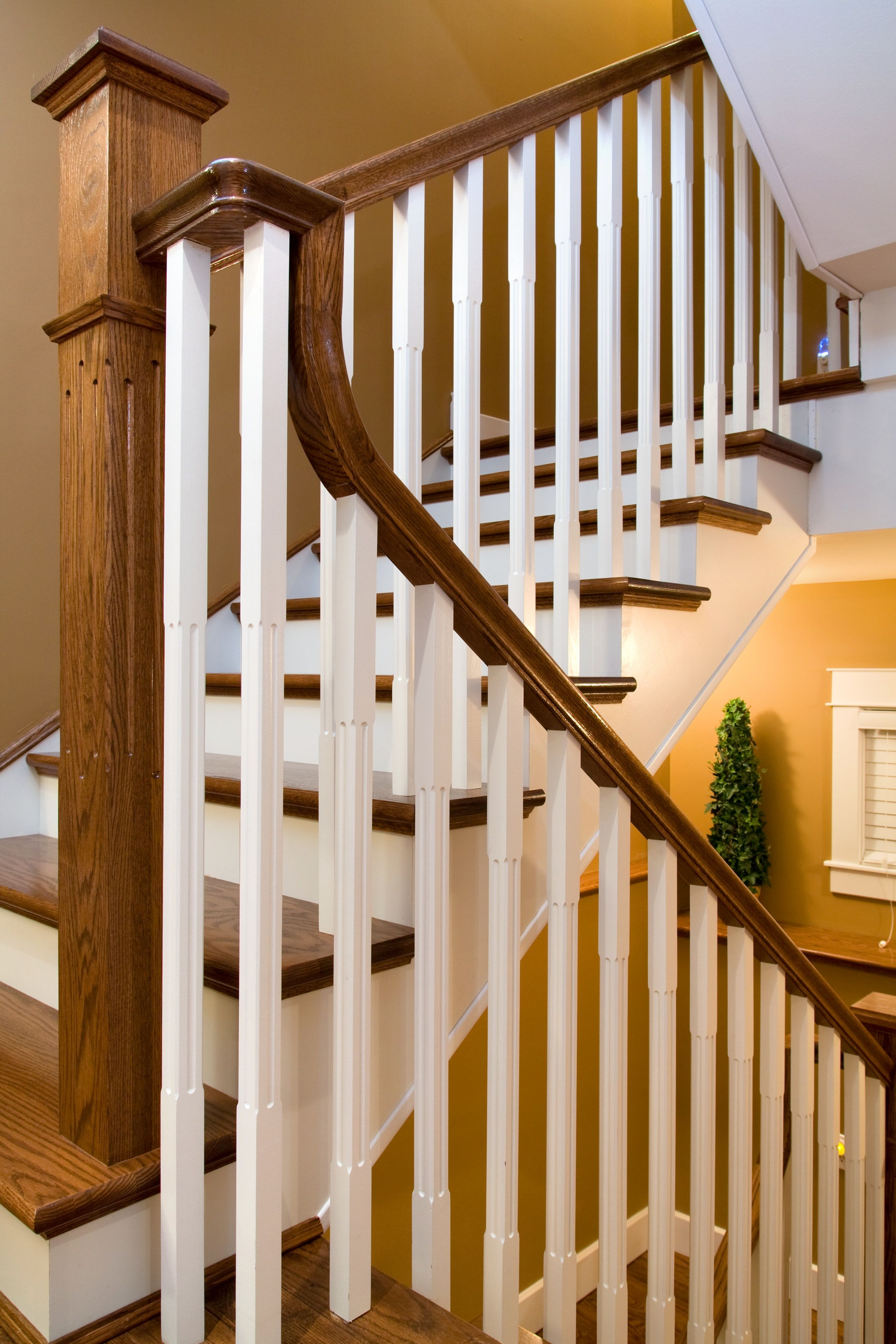 Distinctive Interiors   Dark Oak Sets Off The White Spindles And Risers On  These Custom Built