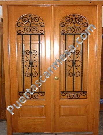 Puerta calle dos hojas medio punto ventanillo y reja for Puertas de madera exterior baratas