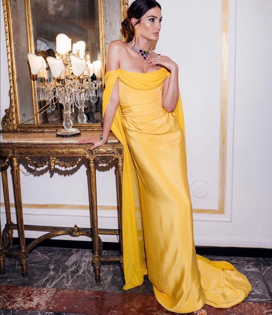 Lilyaldridge Wears A Viviennewestwood Couture Corseted Dress In Draped Sunflower Yellow Silk Crepe With Silk Chif Silk Yellow Dress Dresses Colourful Outfits [ 1249 x 1080 Pixel ]
