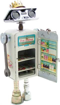 """Name: Martha, Queen of the Kitchen  D.O.B.: 8/23/10  Height: 15""""  Principal Components: Toy refrigerator, opera glasses, wrenches, oil lamp burner, antique button, hydraulic fittings"""