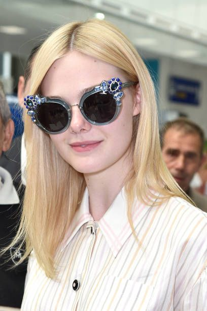 7322821f67c9 Elle Fanning in Miu Miu arrives at Nice airport ahead of the 70th annual  Cannes Film Festival at on May 16 2017 in Cannes France