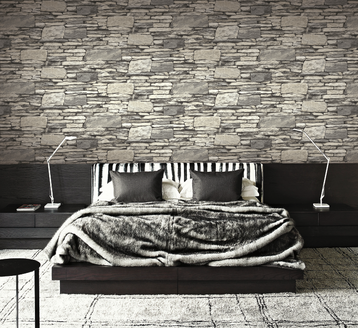 Grey layered stone wallpaper in a modern industrial bedroom from Wallquest's collection Structure. Industrial inspired wallpaper.