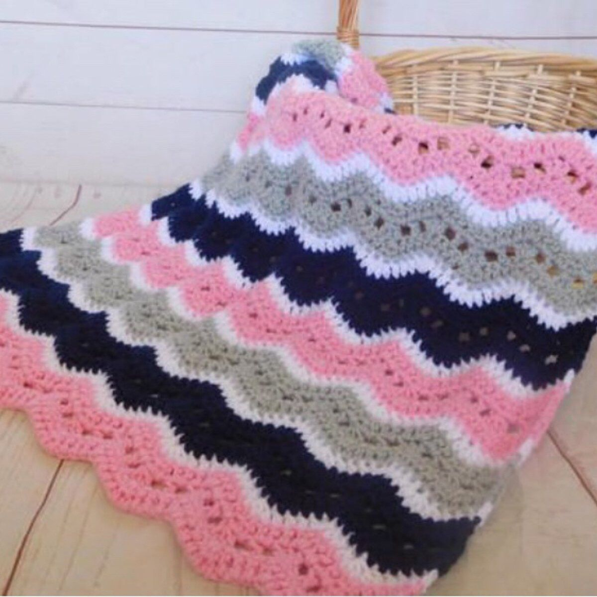 Pink, navy, gray and white crochet baby blanket