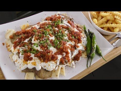 Iskender kebab with tomato sauce and garlic yogurt turkish cuisine iskender kebab with tomato sauce and garlic yogurt turkish cuisine turkish street food forumfinder Choice Image