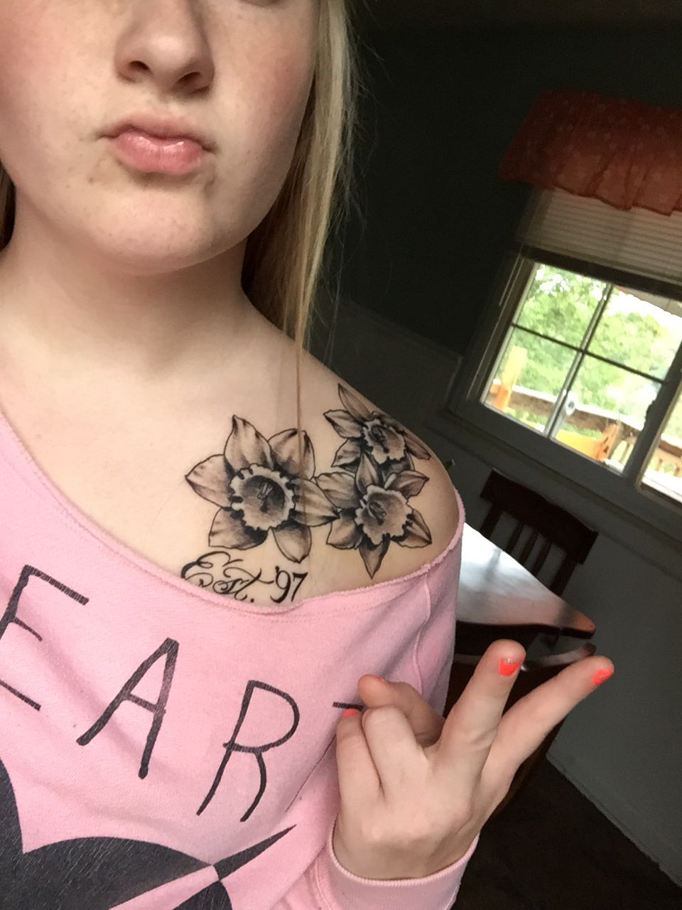 Shoulder Tattoos Daffodils This Girl Is Making A Stupid Face Shoulder Tattoo Tattoos Daffodil Tattoo