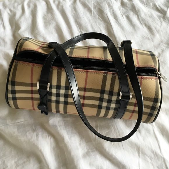 Has some Marks. Not sure if it can be removed or cleaned. Haven t tried.  It s 100% percent authentic. Inside is very clean Burberry Bags 5a9c8486a28b8