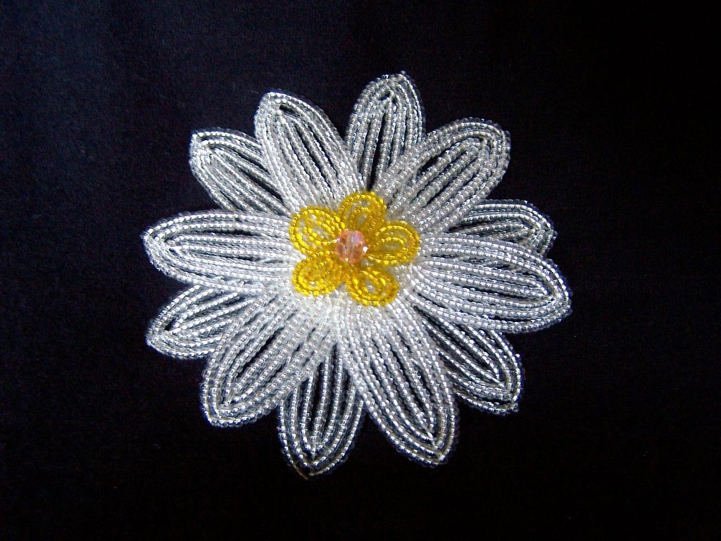 https://flic.kr/p/54dcXe   Clearly Silver and Yellow French Beaded Flower Pin   This flower was made from hundreds of clear seed beads strung on silver-colored wire (these are the petals) and transparent yellow seed beads (and a faceted bead) for the center.