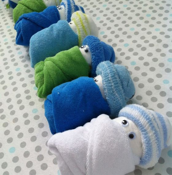 """Unique Baby Shower Gift Ideas - we love these """"diaper babies,"""" a fun alternative to the diaper cake! #babyshower #babygift #giftideas"""