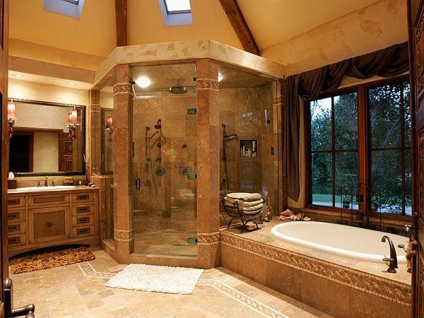 la douche d angle est tres grande les murs sont en pierre la baignoire est en porcelaine il est entoure de pierre