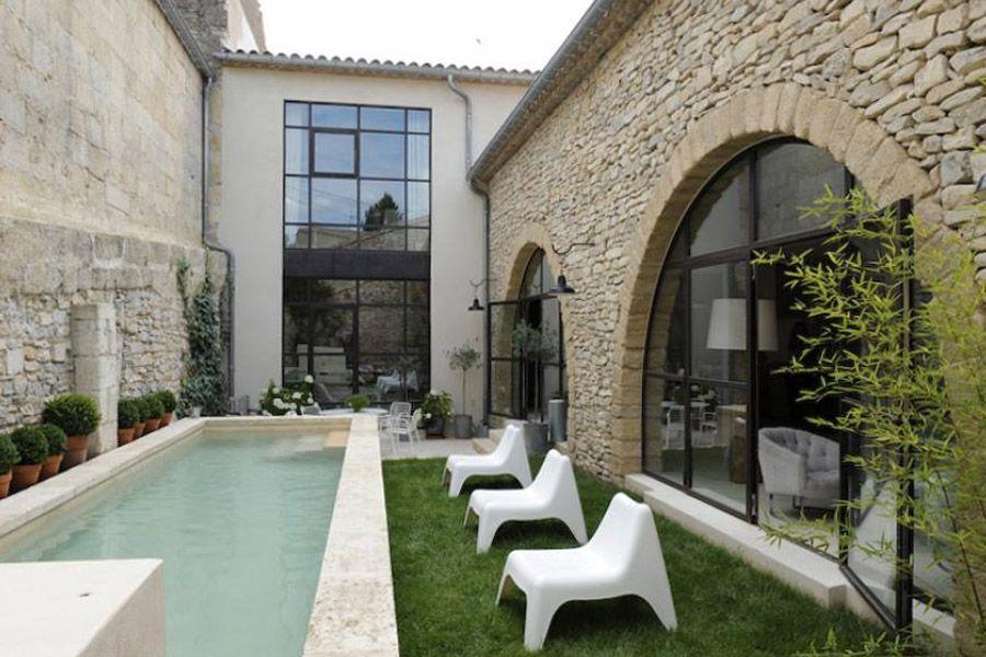 Piscine et mur de pierre exterieurs pinterest for Decoration mur exterieur piscine
