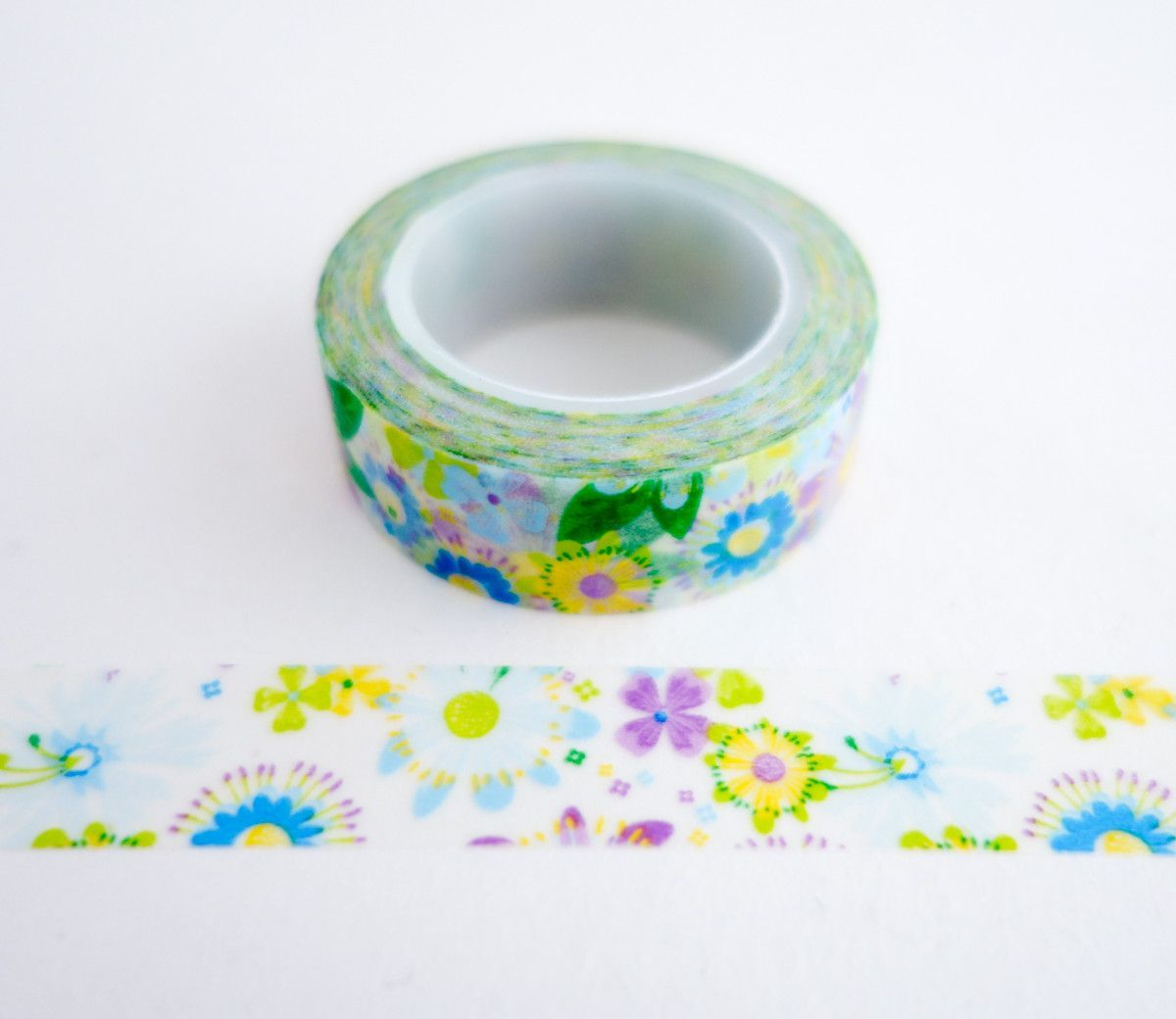 Single roll of washi masking tape with bright spring flowers pattern. Great for travel journals, scrapbooking, gift wrapping, decorating cards and envelopes and more! Add a little dash of cuteness to