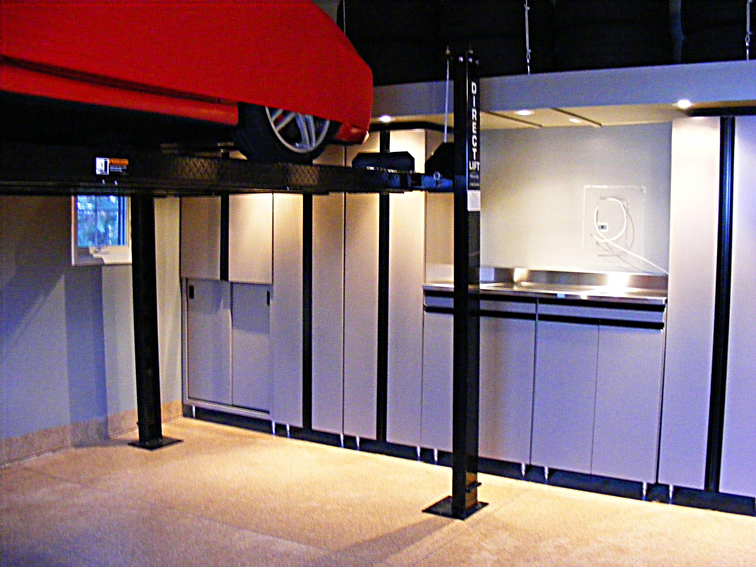 Large Garage Cabinets What A Show Piece Auto Car Lift Garage Cabinets Garage