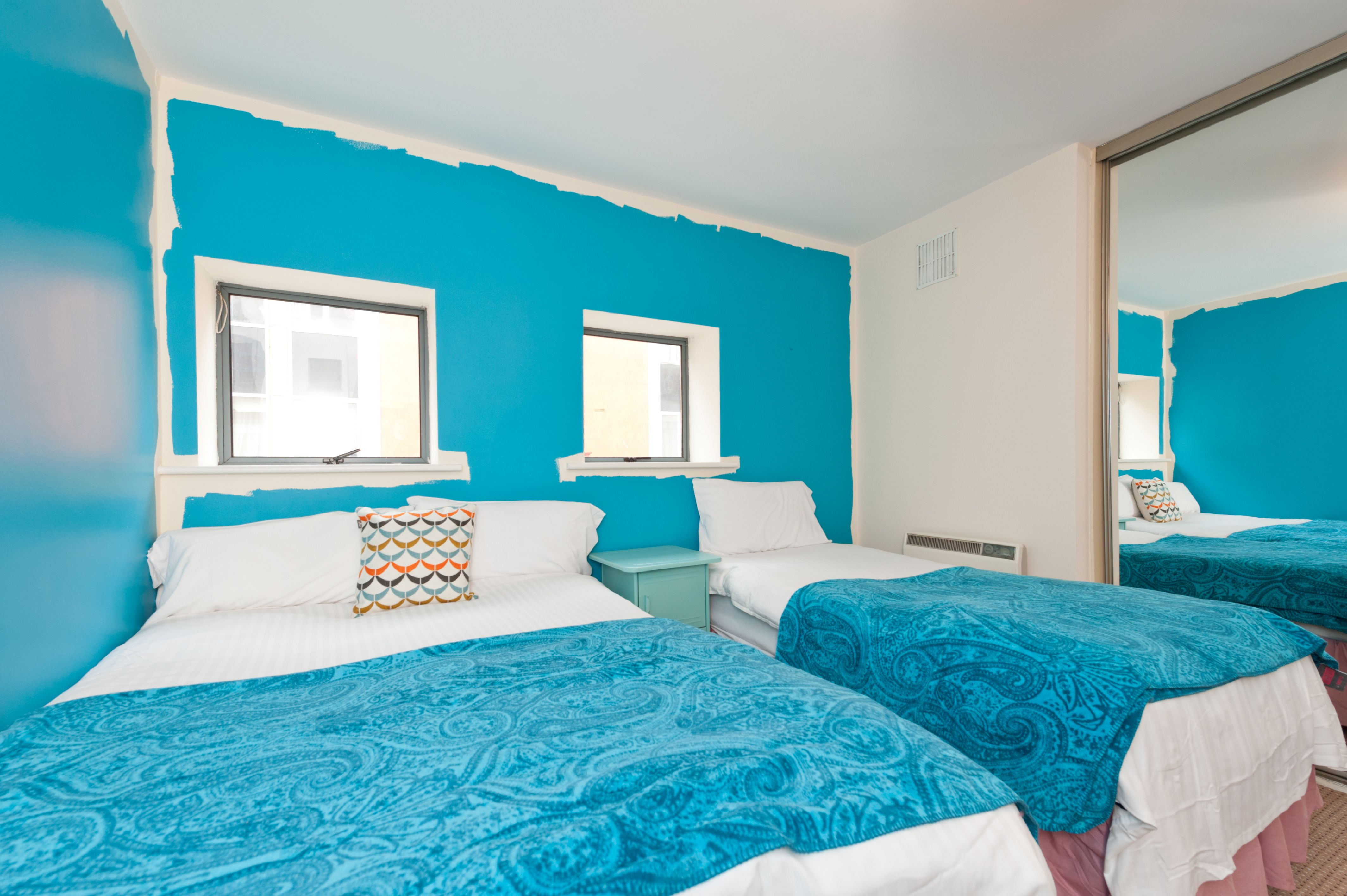 The bright blue bedroom is a great place to unwind