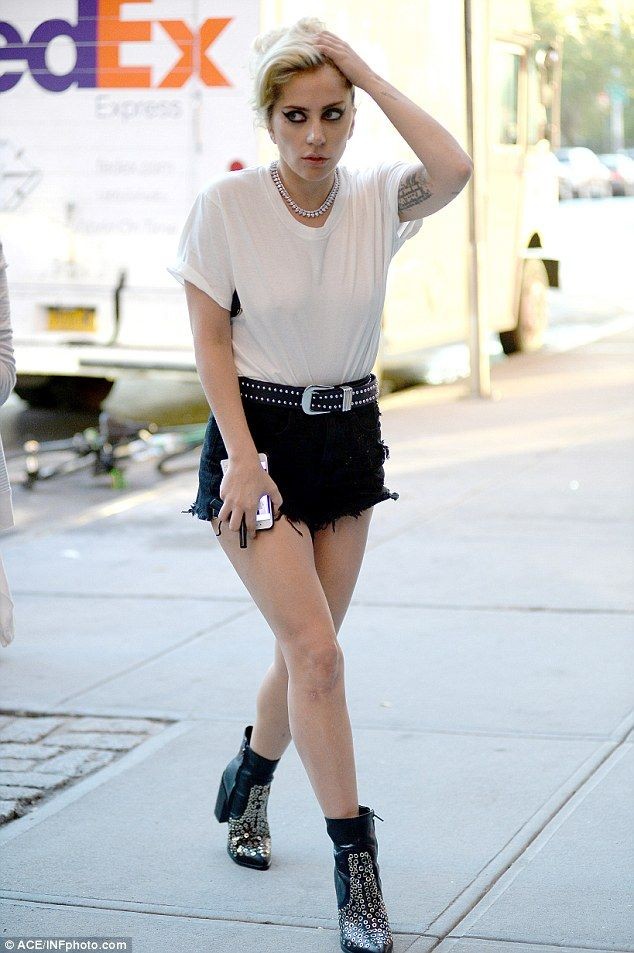 564802ff8199d1 Gaga steps out in frayed black shorts with silver-embellished boots
