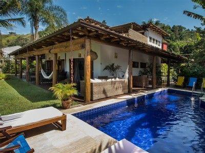 2d6b68ac198a casa Paraty - Casa, terraço e piscina frente praia   hhs   Casa ...