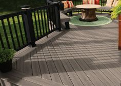 Dark Grey Brown Deck Railing With Lighter Greyish Painted