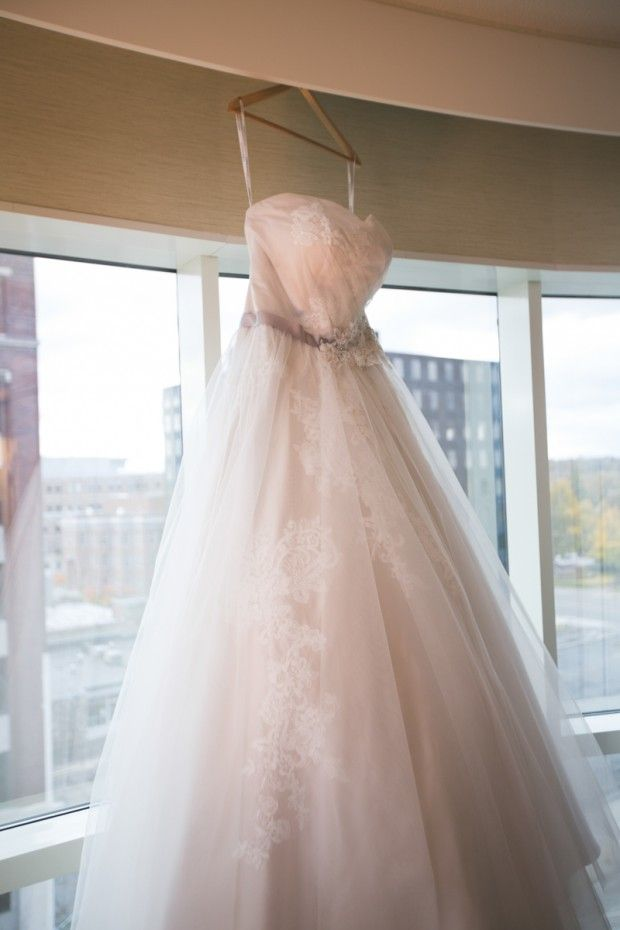 Wedding dress hanging in the windows of a bridal suite at the ...