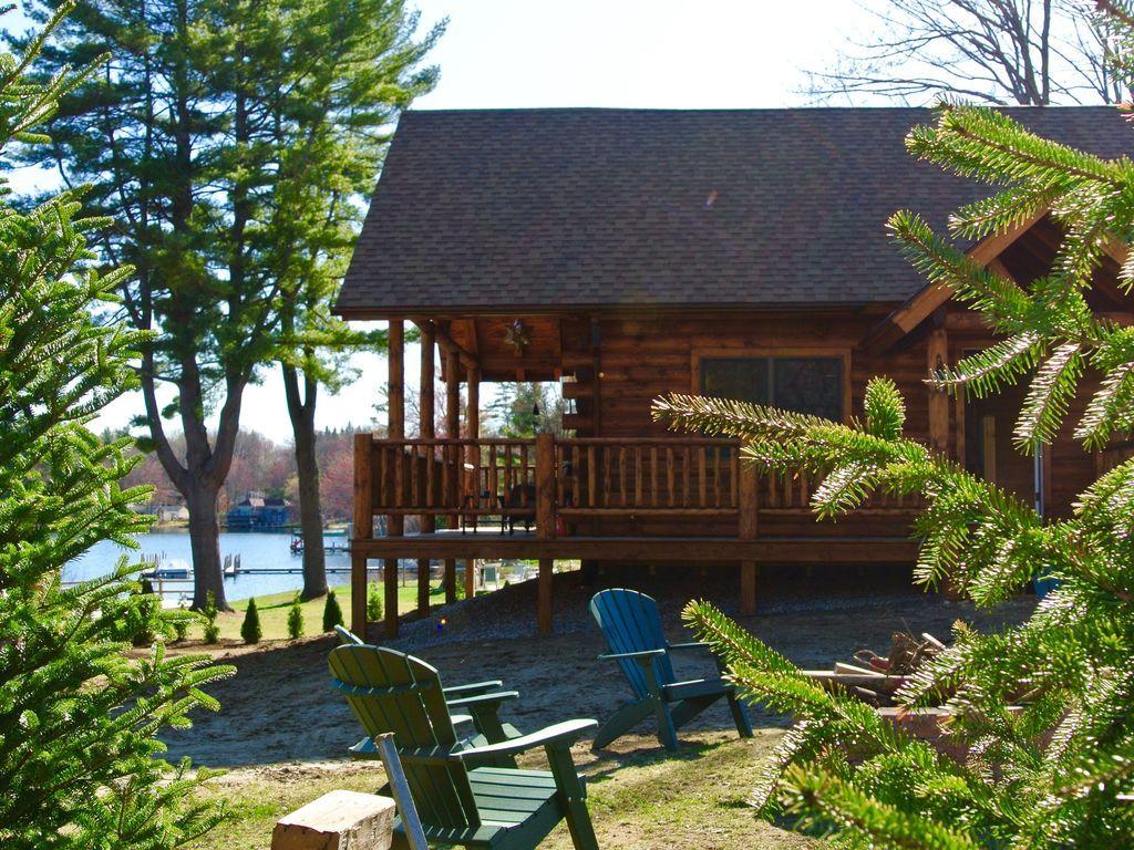 Luxury log cabin lake winnisquam pvt beach boat slip