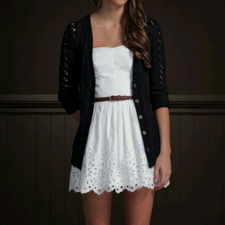 Cardigan over a strapless white Dress w/brown belt.