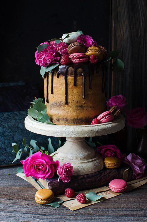 Flourless chocolate almond cake with caramelized white chocolate ganache and ras... Flourless chocolate almond cake with caramelized white chocolate ganache and ras...,