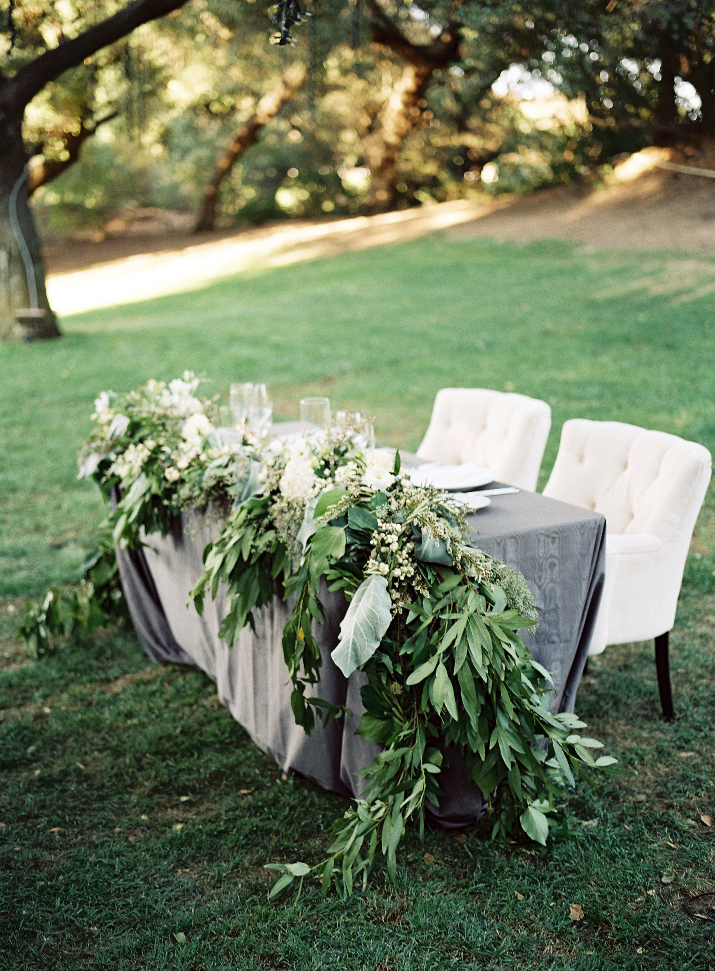 Lush Green Garland Head Table Decor | Holly Flora | Steve Steinhardt  Photography | TheKnot.