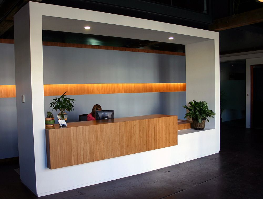 Elevate your office reception desk with amber grain plyboo for Office area design