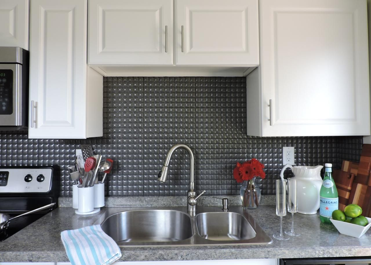 This Quilted Tile Backsplash Is The Focus Of This Small Neutral