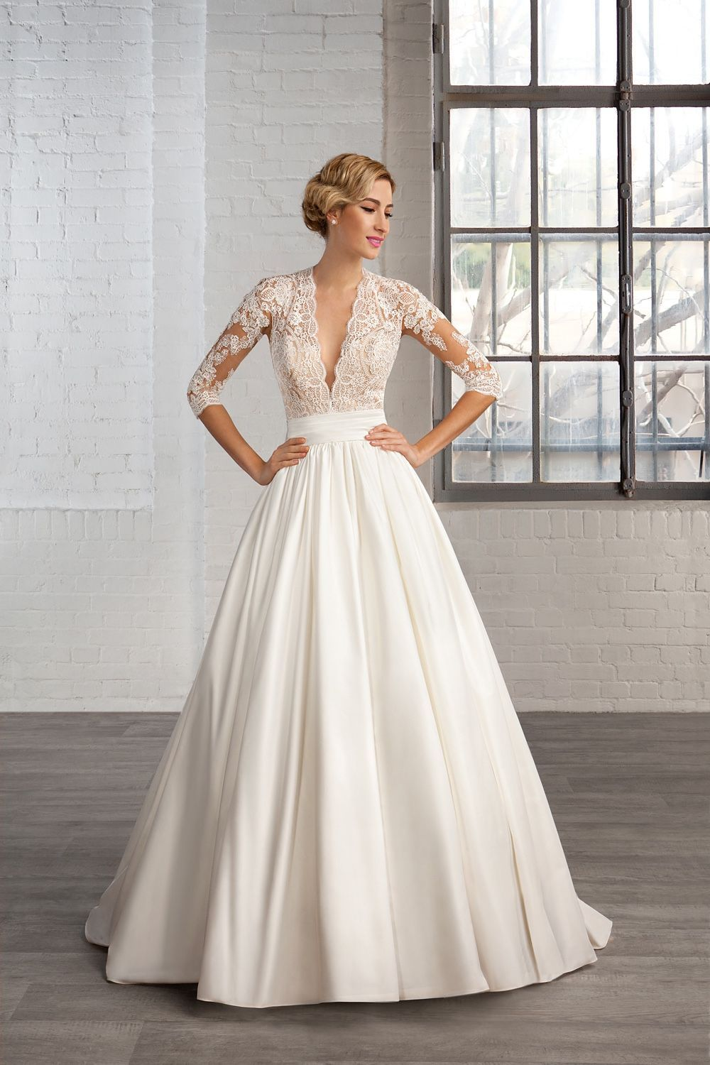 This wedding gown has sheer sleeves down to the elbow.The pretty ...