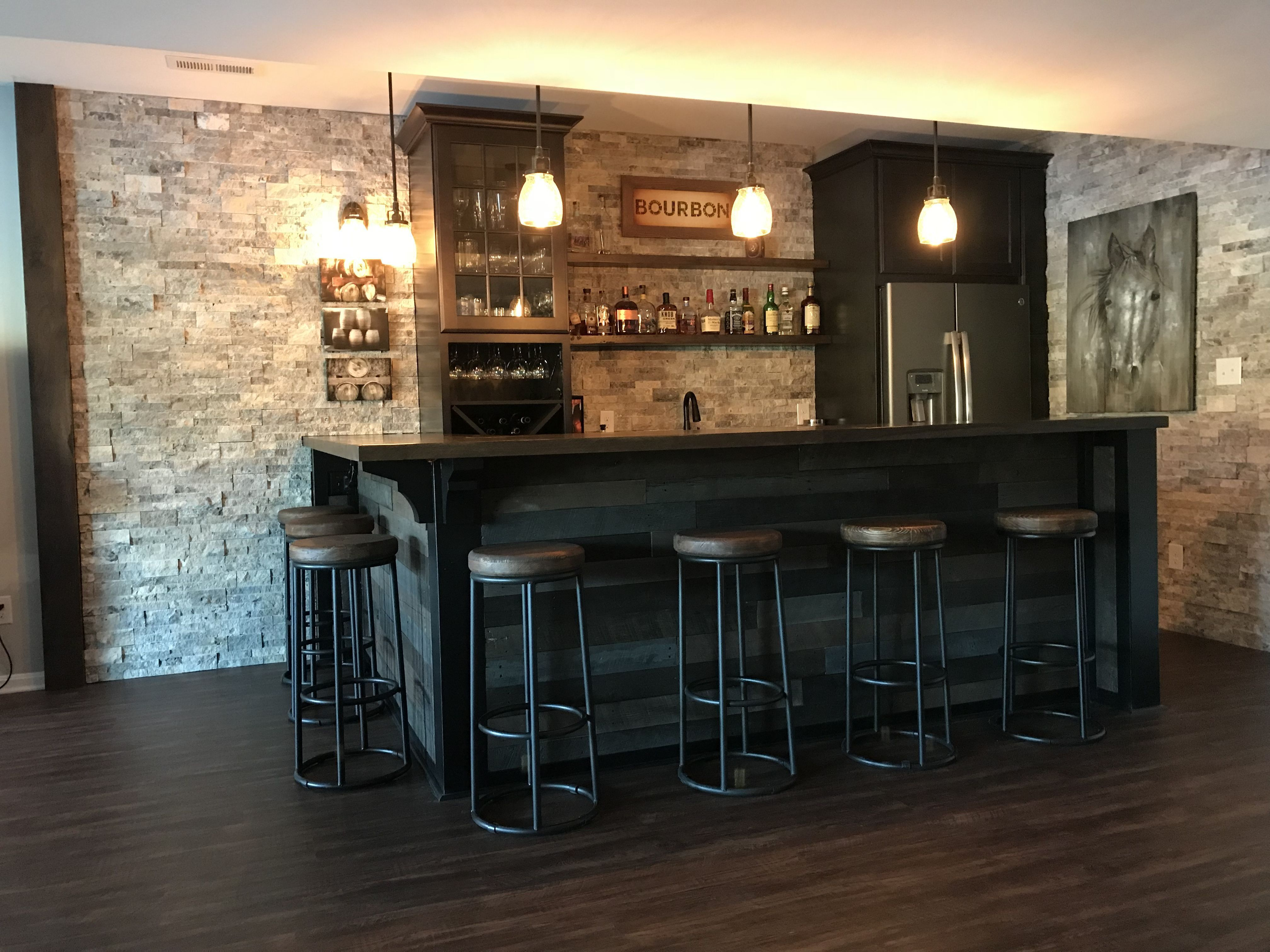 Basement Bar With Stone Backsplash And Dark Wood Stone