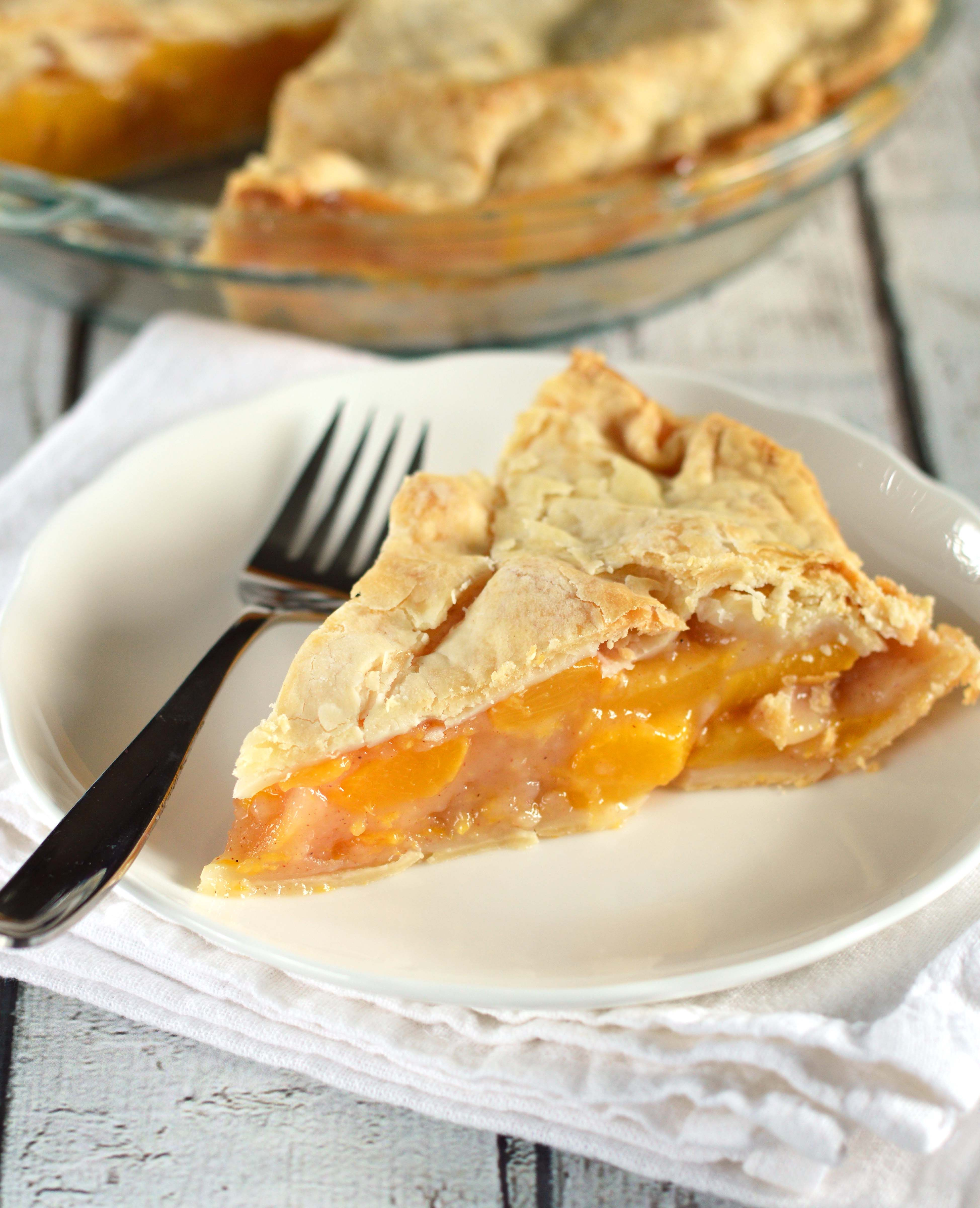 A perfect two crust peach pie recipe made with fresh peaches and simple ingredients.