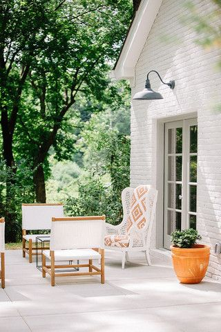 A quaint outdoor space with a large outdoor wall light