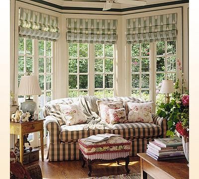 a traditional sitting room gets a playful touch with three roman shades plus itu0027s a great window treatment solution for bay windows