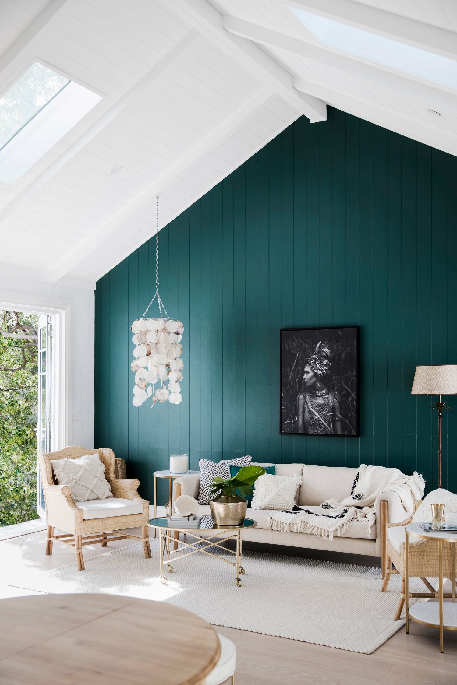 Living Room Feature Wall Design: Raked Ceiling, Green Accent Wall, White And Natural