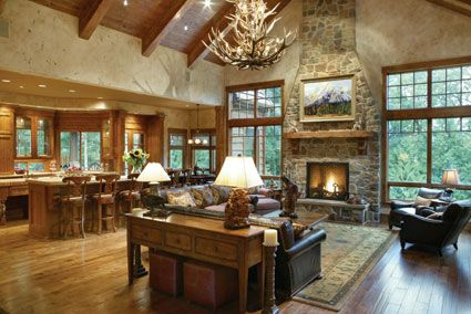 This Mive Vaulted Room Features A Large Stone Fireplace At One End And Formal Dining Area The Other Plan 441015
