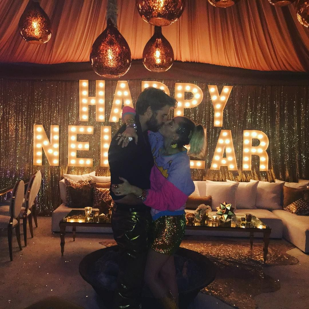 Miley Cyrus and Liam Hemsworth Ring in the New Year With a Sweet Kiss from  InStyle.com | Liam hemsworth and miley, Miley and liam, Liam hemsworth