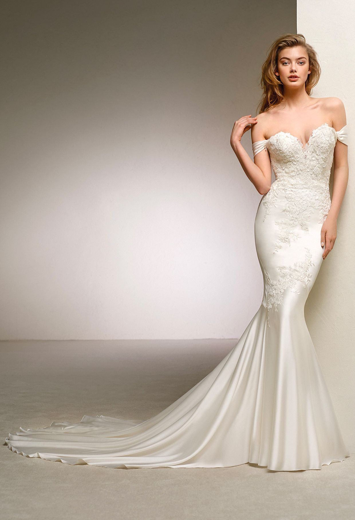 Off the shoulder mermaid wedding gown from pronovias see the new