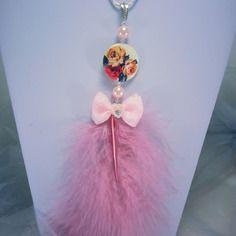 Sautoir ultra féminin, dominante rose dragée, chaine serpentine argentée,entre deux perles rose et toupies cristal swarovski,
