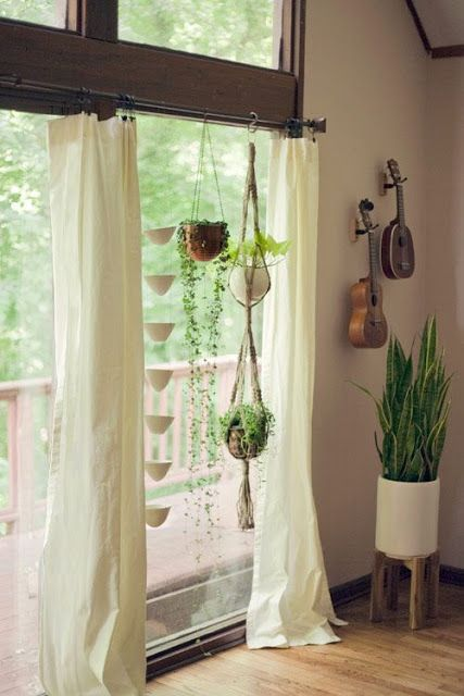 Hanging rope macrame plant hangers from curtain rods in - How to hang plants in front of windows ...