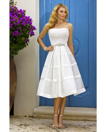 Stella York — Style 5622  This shorter length wedding dress by Stella York is perfect for an elegant and sophisticated summer wedding. The detail at the waist then kicks out to an a-line skirt giving a really classic silhouette. This is also a great gown for showing off a pair of statement wedding shoes.