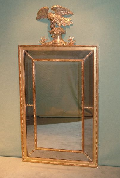 A George III carved giltwood border glass Mirror having beaded frame surmounted by well-carved eagle perched on acanthus leaf decorated plinth.   Circa: 1800