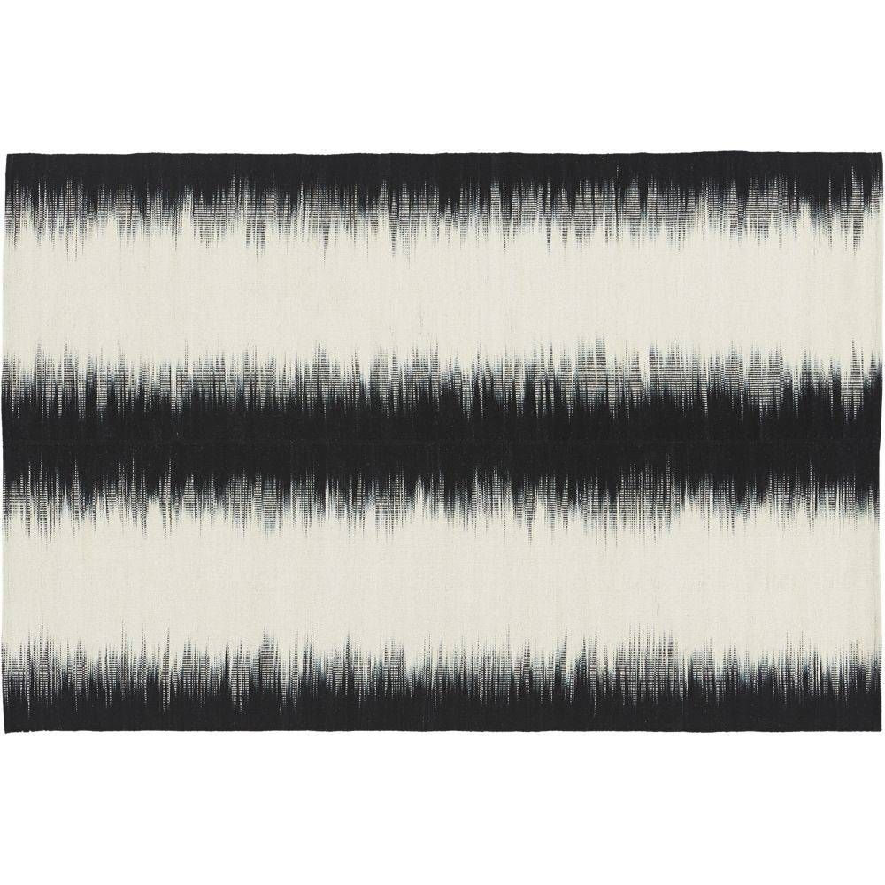 """""""surround sound. Take a graphic stance. High-frequency dhurrie amps the room as visual audio in black/cream. Plush blend of New Zealand/Indian wool and cotton is dyed by hand, then handwoven on a pit loom to positive/negative effect.How will it look in your room? 12""""x12"""" rug samples are available in stores for a fee refundable upon return of the sample. -Handwoven -New Zealand/Indian wool; cotton -Each is unique due to handwoven technique -All surface rug pad recommended -Vacuum re..."""